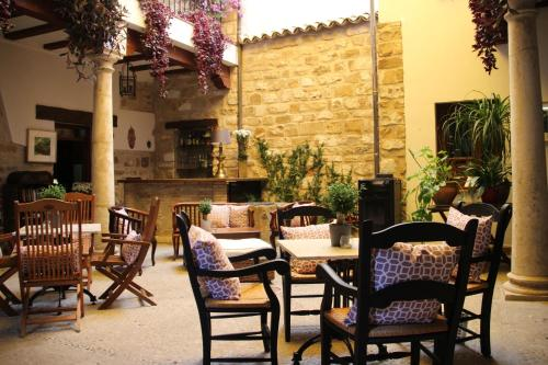 A restaurant or other place to eat at Alvaro de Torres Boutique