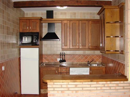 A kitchen or kitchenette at Apartamentos Sierra de Segura