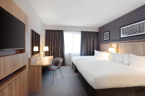 A bed or beds in a room at Jurys Inn London Watford