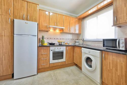 A kitchen or kitchenette at Apartamentos Don Gustavo