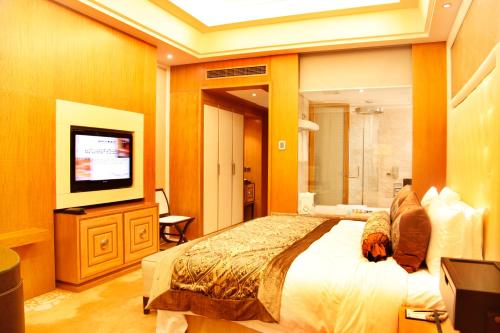Cama o camas de una habitación en Radegast Hotel CBD Beijing