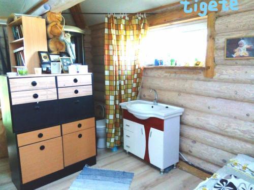 Vannituba majutusasutuses Tigete Holiday Cottage