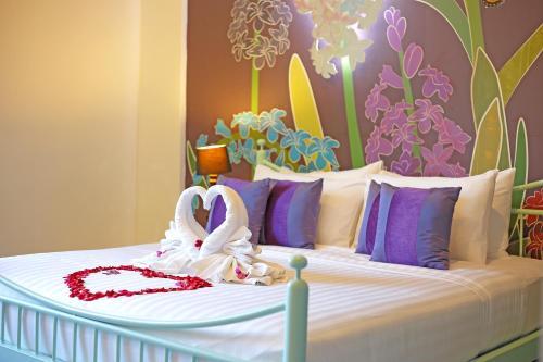 เตียงในห้องที่ Play La Ploen Boutique Resort and Adventure Camp