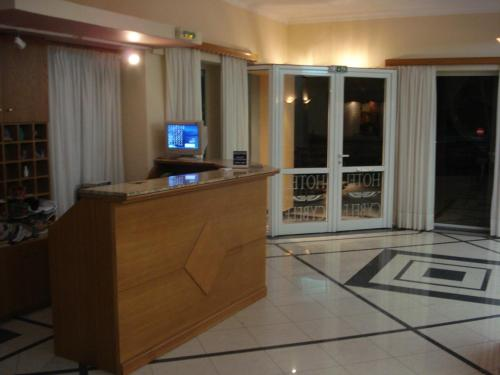 A television and/or entertainment center at Hotel Cybele Pefki