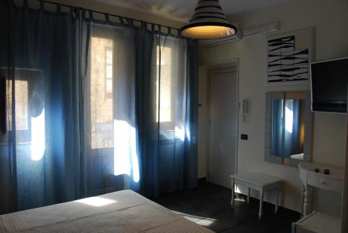 A bed or beds in a room at Locanda Re Ruggero