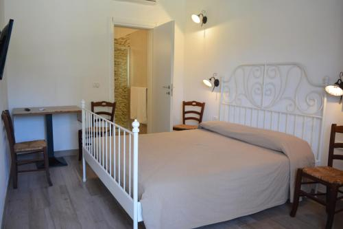 """A bed or beds in a room at Agriturismo """"Terra D'Ulivi"""""""