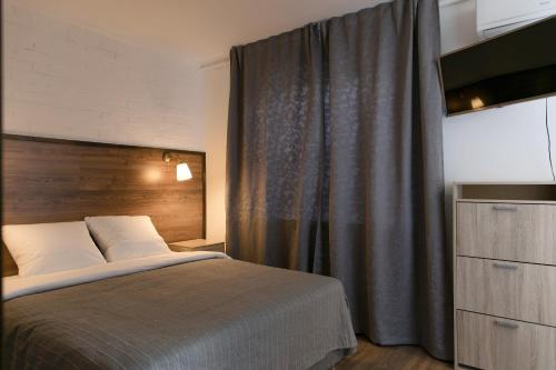 Кровать или кровати в номере Hotel Panfilof