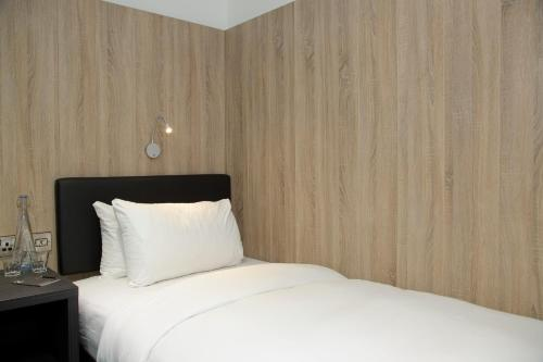 A bed or beds in a room at The Z Hotel Gloucester Place