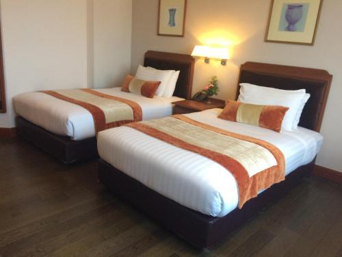 เตียงในห้องที่ โรงแรมท็อปแลนด์