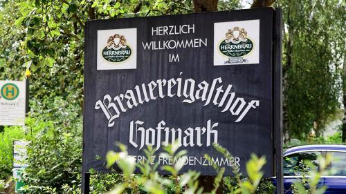 Das Logo oder Schild des Gasthauses