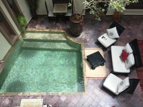 A view of the pool at Riad Jardin Des Rêves or nearby