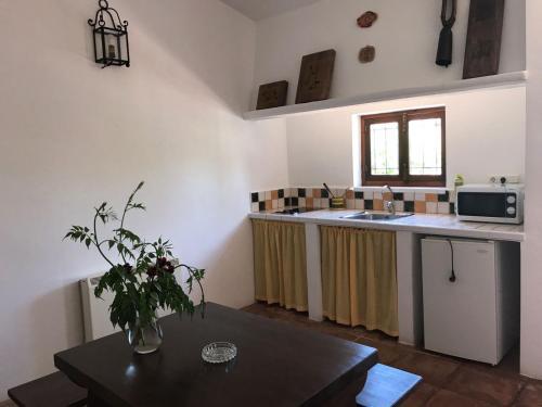 Una cocina o zona de cocina en Cortijo Nuevo Alojamiento Rural
