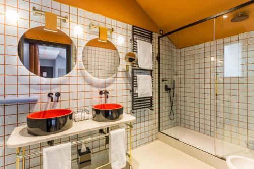 Un baño de Room Mate Giulia