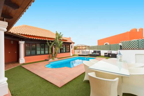 The swimming pool at or close to Villa Corralejo Beach