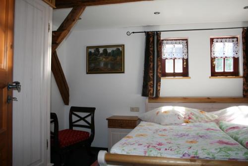 Ein Bett oder Betten in einem Zimmer der Unterkunft Auszeithof