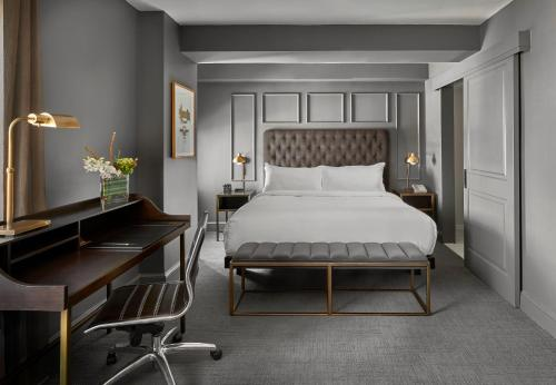 A bed or beds in a room at Hotel Phillips Kansas City, Curio Collection By Hilton
