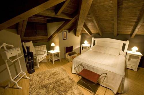 Cama o camas de una habitación en Complejo Turístico L'oteru