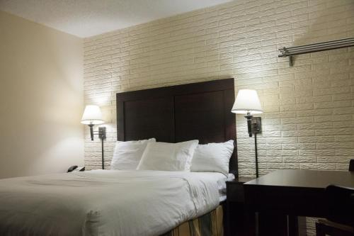 A bed or beds in a room at Inns of Virginia Arlington