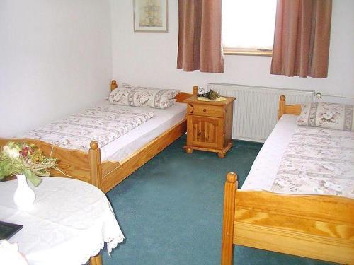 Ein Bett oder Betten in einem Zimmer der Unterkunft Pension Torgau - Zimmer 5