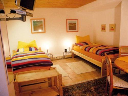 Ein Bett oder Betten in einem Zimmer der Unterkunft 2 Zimmer-Appartement Seerose