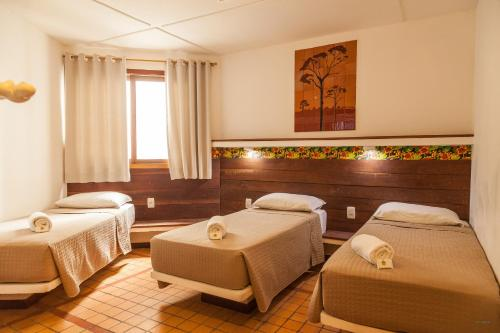 A bed or beds in a room at Pousada Bahia Brasil