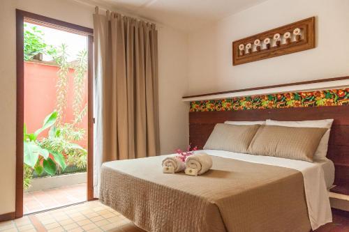 Cama ou camas em um quarto em Pousada Bahia Brasil
