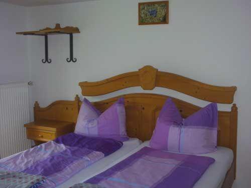 Ein Bett oder Betten in einem Zimmer der Unterkunft Ferienwohnung Meislerlehen