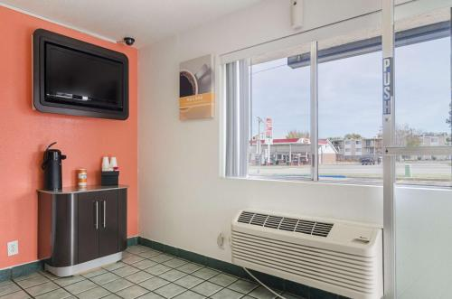 A television and/or entertainment center at Motel 6-Topeka, KS - Northwest