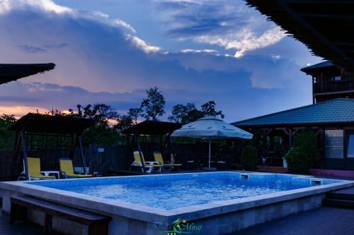 The swimming pool at or near Pension Delta Miraj