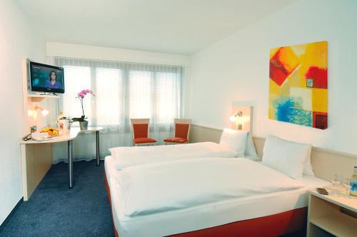 Ein Bett oder Betten in einem Zimmer der Unterkunft Hotel Rondo
