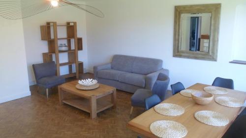 A seating area at La Maison de Mes Parents
