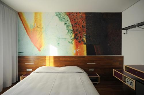 Postel nebo postele na pokoji v ubytování Alloggi Taverna Caorlina
