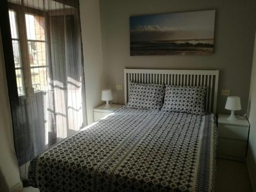 Cama o camas de una habitación en APARTAMENTOS POBRA-CASTELO