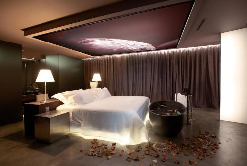 A bed or beds in a room at The Vine Hotel