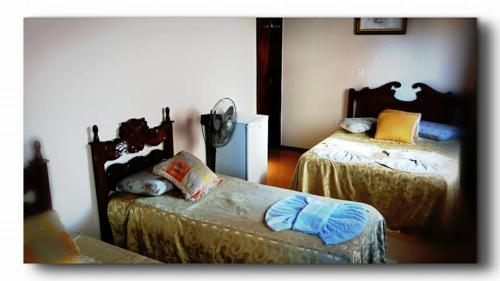 A bed or beds in a room at Hotel Flórida