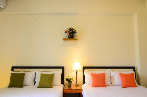 A bed or beds in a room at East of Love Homestay
