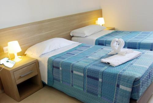 A bed or beds in a room at Albergo Dolcedo