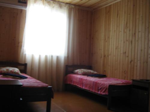 Кровать или кровати в номере Гостевой дом Чайка