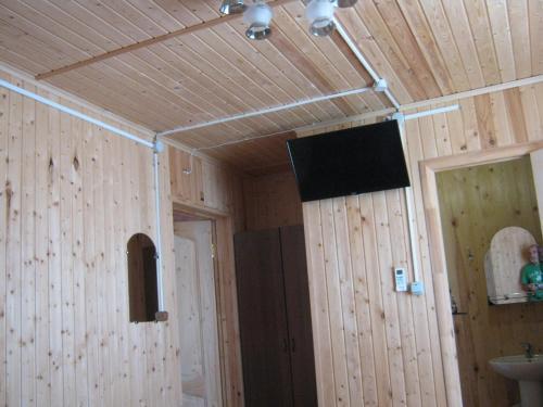 Телевизор и/или развлекательный центр в Гостевой дом Чайка