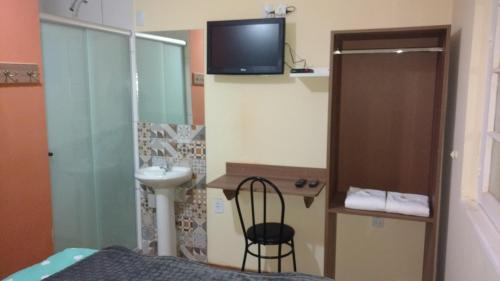 A television and/or entertainment centre at Lotus Hotel & Hostel