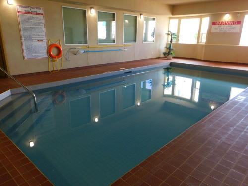 The swimming pool at or near Western Budget Motel & Suites #3 Leduc/Nisku