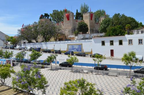 The swimming pool at or near Hotel Torres Novas
