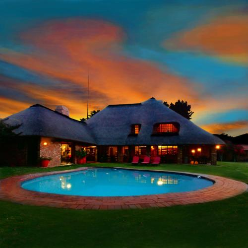 The swimming pool at or close to African Footprints Lodge