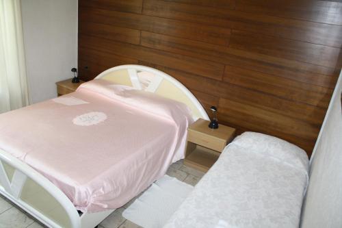 Un ou plusieurs lits dans un hébergement de l'établissement Albergo Stazione