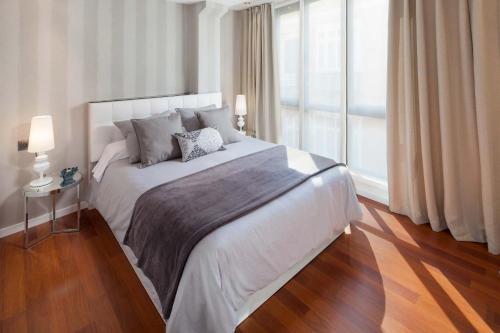 Säng eller sängar i ett rum på INMálaga Constitución