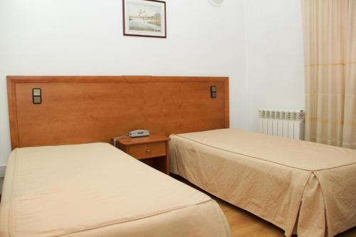 A bed or beds in a room at Residencial Parque