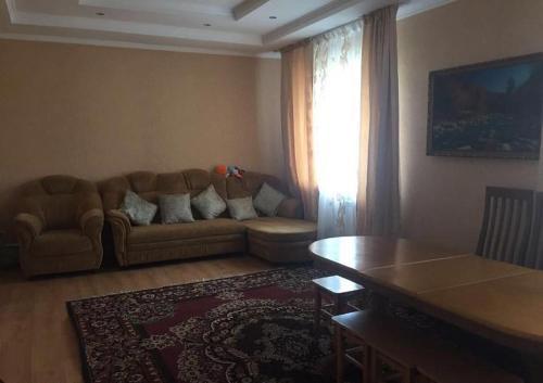 A seating area at Usadba u Olgi Holiday Home