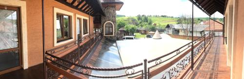 A balcony or terrace at Minihotel Zolotoe Runo