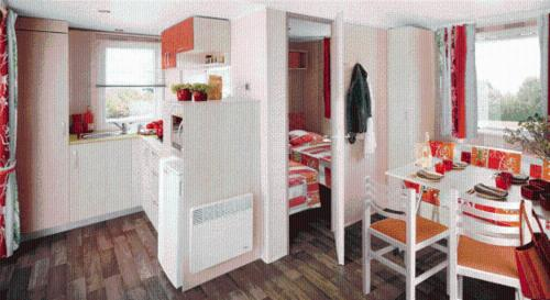 A kitchen or kitchenette at Camping Chantemerle