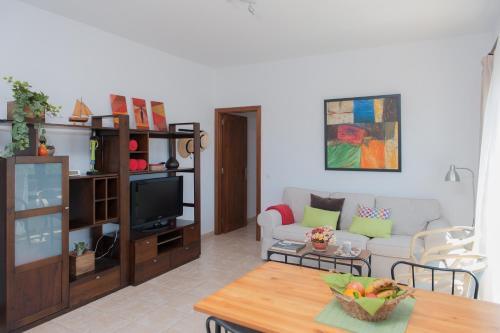 Ein Sitzbereich in der Unterkunft Oasis de Nazaret